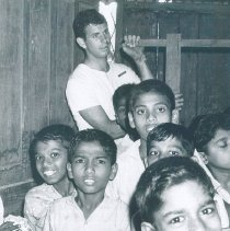 Image of John Baker on cleanup day at Maradana School in Ceylon.