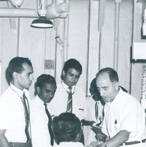 Image of Abid Karam wth counterparts and Patient on the SS HOPE in Ceylon.