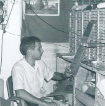 Image of Andy Spofford working in the hold on the SS HOPE in Ceylon.