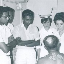 Image of Ann Bennett and Judy Shaw with counterparts on the SS HOPE in Ceylon.