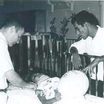 Image of Sam Stokley with a medical student and patient on the SS HOPE in Ceylon.