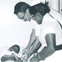 Image of Paul Altrocchi with patient on the SS HOPE in Ceylon.
