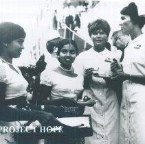 Image of Inge Hansen and unknown nurse at Arrival Ceremonies in Ceylon.