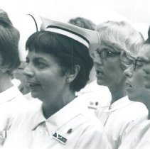 Image of Dorothy Aeschliman singing with nurses on the SS HOPE in Ceylon.