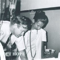 Image of Thomas Bowles with nurse on the SS HOPE in Ceylon.