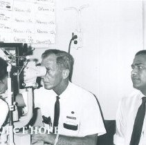Image of Charles Foote examines a patient with Ernest DeMil observing in Ceylon.
