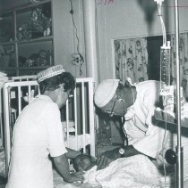 Image of Robert Dripps and unknown nurse with patient on the SS HOPE in Ceylon.