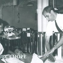 Image of David Furnas with patient and nurse on the SS HOPE in Ceylon.
