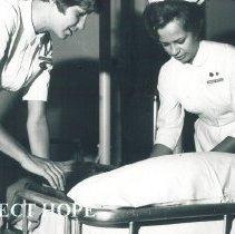Image of Carol Curry and Rosanna Schmitt on the SS HOPE in Ceylon.