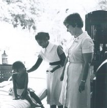 Image of Barbara Miller with patient in Kandy General Hospital in Ceylon.
