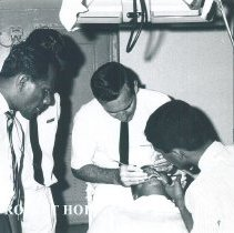 Image of Paul Sommer and counterparts in Dental Clinic on the SS HOPE in Ceylon.