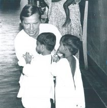 Image of Dick Daniels with Pediatric patients at Kandy General Hospital in Ceylon.