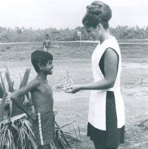 Image of Sylvia Lawrence with a young Ceylonese boy in Ceylon.