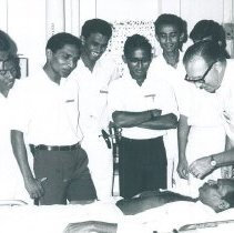 Image of Elmer Diskan with med students on the SS HOPE in Ceylon.