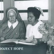 Image of Sister Charles Marie Frank with student  in Trujillo, Peru.