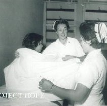 Image of Pat Sweet with patient and counterpart in Turjillo, Peru.