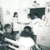 Image of Medical Post where an Aux Nurse is giving a health talk in Turjillo, Peru.