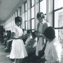 Image of Sandra Deerhake with counterpart and patients in Hospital in Trujillo, Peru