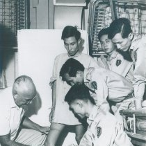 Image of An unknown HOPE doctor with counterparts on the SS HOPE in Saigon, Viet Nam