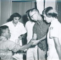 Image of Unknown nurse and doctor with patient on the SS HOPE on Voyage I 1960.