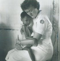 Image of Mary Jane Damuth with patient on the  SS HOPE in Indonesia.