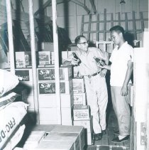 Image of Chief storekeeper with counterpart on SS HOPE in Indonesia.