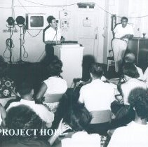 Image of William B Walsh in lecture room on the SS HOPE in Saigon Vietnam 1960.