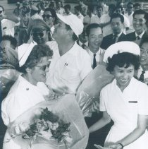 Image of Nurses bidding farewell with William B Walsh as SS HOPE leaves Saigon 1961