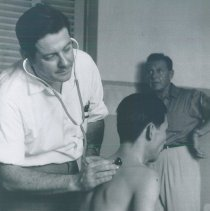 Image of William B Walsh with patient and Ralph Bellamy on SS HOPE in Vietnam.