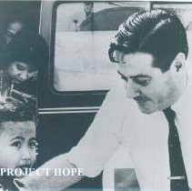 Image of William B Walsh with young Vietnamese patient in Saigon in 1960.