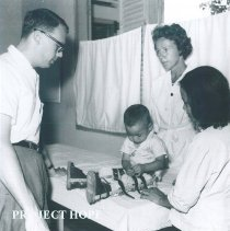 Image of Unknown doctor and nurse with patient in rehabilitation center in Saigon.