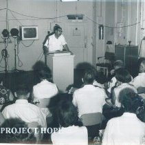 Image of Martin Kohn in lecture room on the SS HOPE in Vietnam 1960.