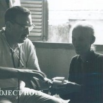 Image of Martin Kohn with patient while on the SS HOPE in Vietnam 1960.