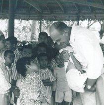 Image of Gene Schulze with patients at Bien Hoa mental hospital in Vietnam.