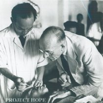 Image of Unknown doctor with counterpart on the SS HOPE in Indonesia 1960.