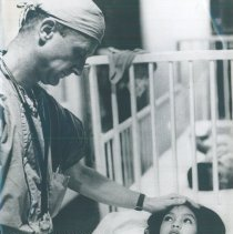 Image of Craig Leman with patient on the SS HOPE in Indonesia 1960.