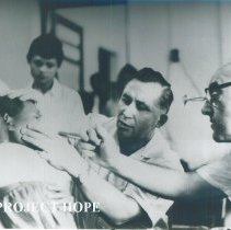 Image of Unknown doctor doing an eye exam on the SS HOPE in Indonesia 1960.