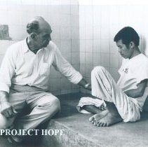 Image of Unknown doctor with patient while SS HOPE was in South Vietnam 1960.