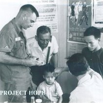 Image of George Brockman in a hamlet with US Army Sargeant in South Vietnam 1960.