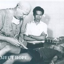 Image of Unknown doctor with patient  while the SS HOPE was in South Vietnam 1960