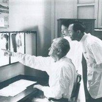 Image of SS HOPE John Adams with counterpart at Bihn Dan Hospital in  Vietnam 1960