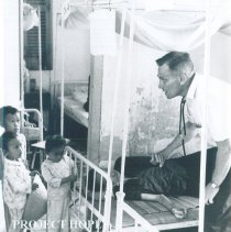 Image of SS HOPE George Brockman with patient at Tan An Hospital in Vietnam 1960