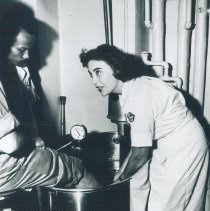Image of Nurse Sue Glocke with counterpart on SS HOPE in Indonensia 1960