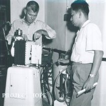 Image of Leo Haney repairs equipment on SS HOPE in Indonesia 1960.