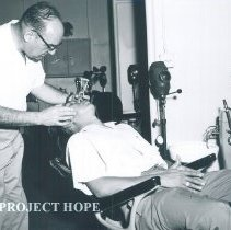 Image of Dr Tischer in the dental clinic on the SS HOPE in Indonesia 1960