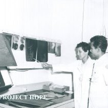 Image of Rene Beauregard Medical Technologist with counterpart on SS HOPE 1960