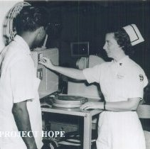 Image of Fran Harris with counterpart on the SS HOPE in Indonesia 1960