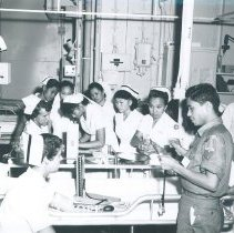 Image of Ann Roden MacGregor and Lottie Reich with nurse class on SS HOPE 1960