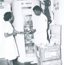 Image of Nurse Emmy Zahari and Med Tech Richard Neal on SS HOPE Indonesia 1960