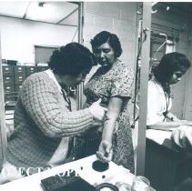 Image of HOPE Health Assistant and Health Dept nurse working in Laredo Texas 1969.